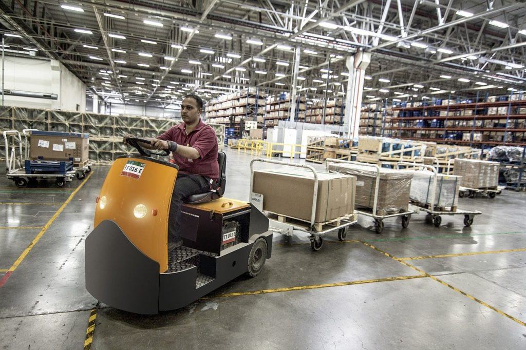warehouse worker operating a machine
